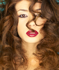 young beautiful lady with big frizzy curls and red lips