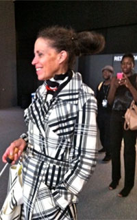Girl in coat with a big hair bun