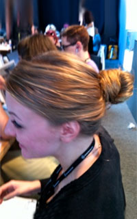 Woman with an auburn hair bun