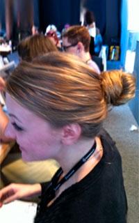 Woman with an auburn hair bun