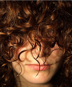 lady with her curls covering her eyes