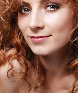 lovely curly redheaded lady smiling