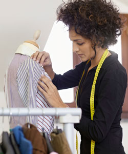 seamstress with curly hair working