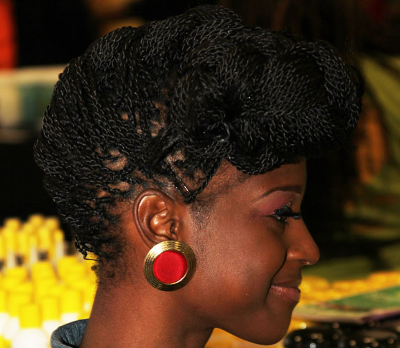 twists braided up into big front bun updo