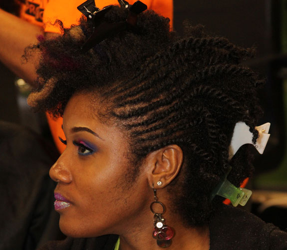 natural hair being styled with small flat twists