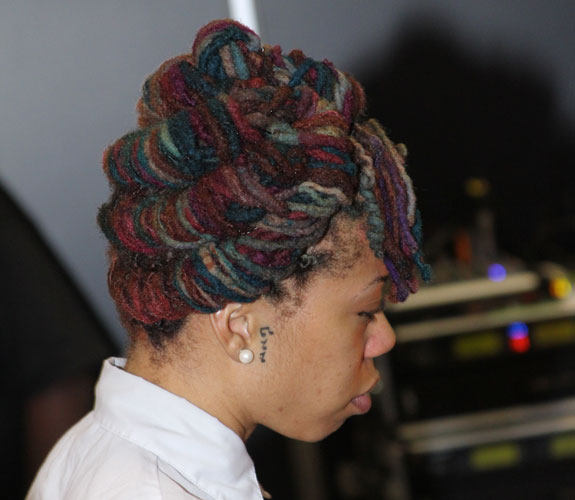 yarn colored locs twisted into layered updo