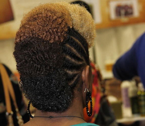 blonde, caramel and brown color crimped buns from flat twisted fro-hawk