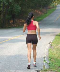 lady with curly hair jogging