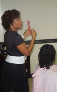 lisa getting professional finger coils by Candace Walls of Sovereign Styles Hair Studio