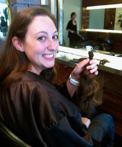 Nicole Binnicker holding her ponytail
