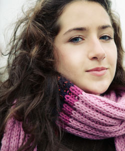 girl with wavy hair wearing a scarf