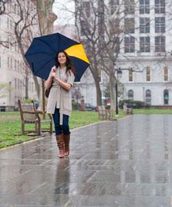 stylish lady with wavy hair walking through the rain