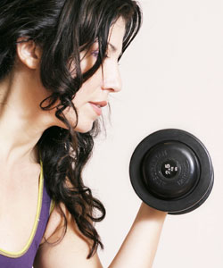 Lady with curly hair lifting weight