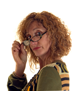 Middle-aged lady with curly hair, wearing glasses