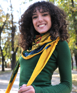 Curly wearing yellow scarf over sweater