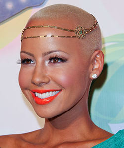 Amber Rose wearing a gold headband