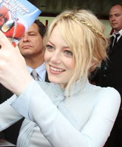 Emma Stone wearing a gold hair accessory