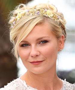 Kirsten Dunst in a flower hair accessory