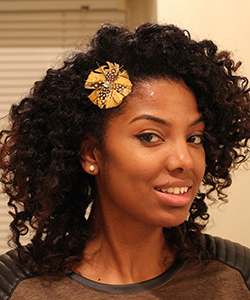 Woman wearing a protective hairstyle