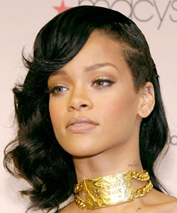Rihanna with a half shaved hairstyle