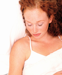 Curly haired woman sleeping