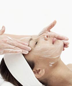Woman receiving a facial