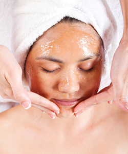 Woman receiving a honey facial mask