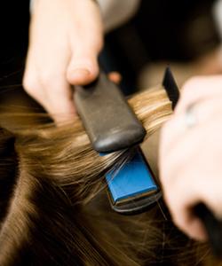 Straightening hair with flat iron