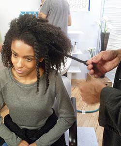 Twist outs on Coily Model at L'Oreal Paris EverCurl video shoot