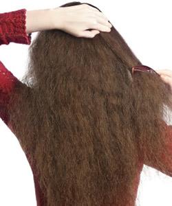 Woman brushing curly hair