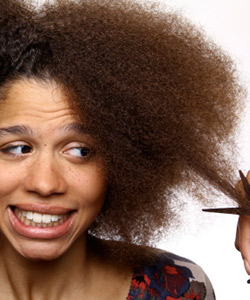 Curly haired woman nervous for haircut