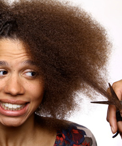 Curly haired woman getting a Mini Chop haircut