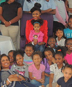 CurlyNikki with young girls from Girls Inc.