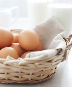 Basket of eggs with milk