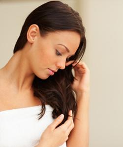 Woman finger combing her hair