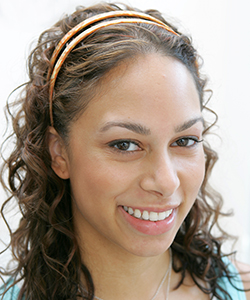 Curly haired woman with a headband