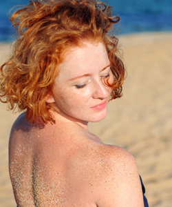 Curly haired woman on beach