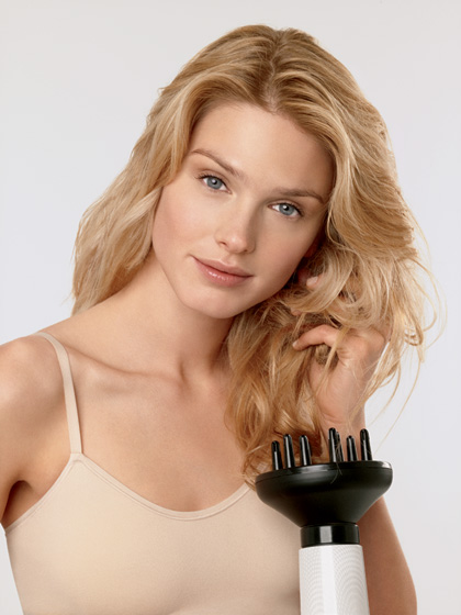 Wavy haired woman diffusing her hair