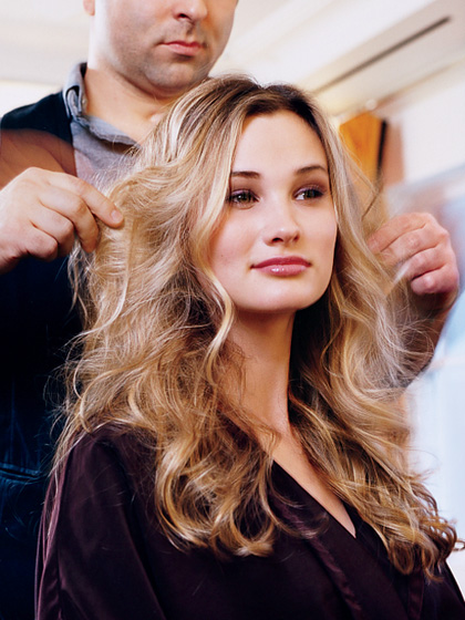 Wavy haired woman getting dry haircut
