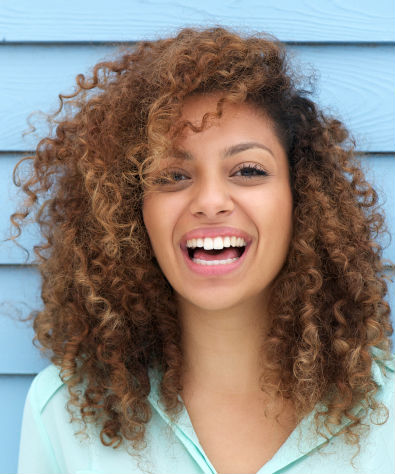 laughing girl with curly hair