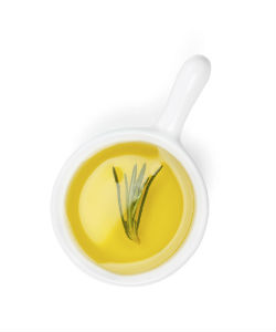 How to Fix Your Greasy Scalp Situation with Rosemary Oil