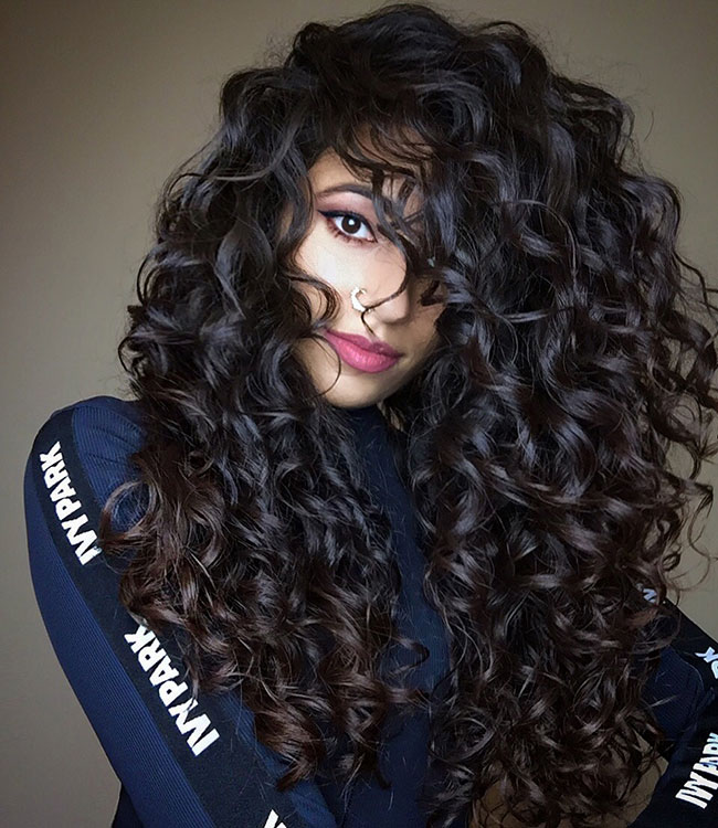 this is how ayesha styles her long naturally wavy hair