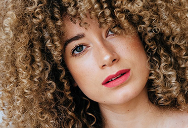 Here Are 5 Ways To Style Your Curly Bangs For The Summer