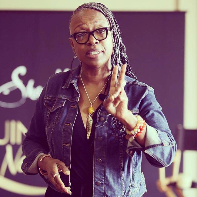 Master Stylist, SheaMoisture Brand Ambassador Diane C. Bailey giving instructions to class